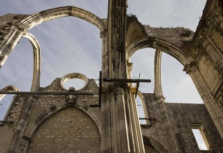 damaged roof: LISBON, PORTUGAL - OCTOBER 24 2014: Looking up at the damaged roof of Carmo Convent in Lisbon, roofless due to the Lison eartquake