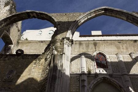 roofless: LISBON, PORTUGAL - OCTOBER 23 2014: Looking up at Carmo Convent in Lisbon, roofless due to Lisbon earthquake. Architectural close up Editorial