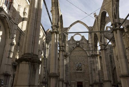chiado: LISBON, PORTUGAL - OCTOBER 24 2014: Interiors of the roofless Carmo Convent in Lisbon, ruined by the earthquake