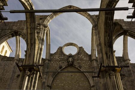 carmo: LISBON, PORTUGAL - OCTOBER 23 2014: Looking up at Carmo Convent in Lisbon, roofless due to Lisbon earthquake. Architectural close up Editorial