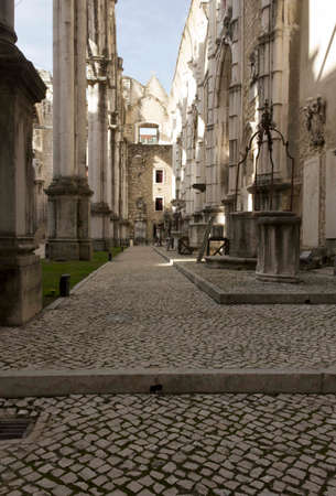 carmo: LISBON, PORTUGAL - OCTOBER 24 2014: Inside the ruins of Carmo Convent in Lisbon, lateral corridor damaged by the earthquake Editorial