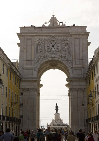 augusta: LISBON, PORTUGAL - OCTOBER 24 2014: People walking in Rua Augusta, with the triumphal arch and equestrian statue in the background