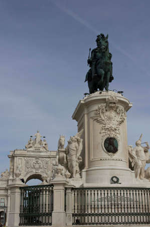 augusta: LISBON, PORTUGAL - OCTOBER 24 2014: Architectural close up of the equestrian Statue of King Joseph and Rua Augusta Arch in Commerce square in Lisbon