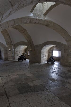 niches: LISBON, PORTUGAL - OCTOBER 24 2014: Interior casemate of the main bastion of Belem Tower in Lisbon, showing the cannon niches