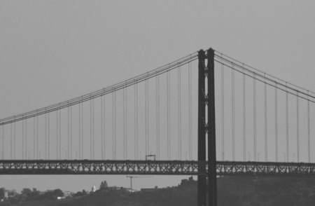 25th: LISBON, PORTUGAL - OCTOBER 24 2014: Close up detail of 25th of April bridge in Lisbon, Portugal, monochrome edited