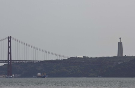 25th: LISBON, PORTUGAL - OCTOBER 24 2014: View of 25th of April Bridge and Cristo Rei from Belem Tower
