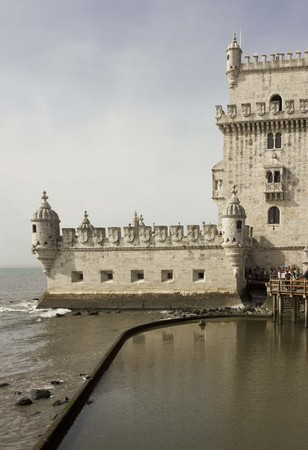 patrimony: LISBON, PORTUGAL - OCTOBER 24 2014: external View of Belem Tower of Lisbon, Portugal, with people waiting to enter