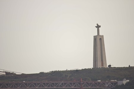 hill of the king: View from the distance of Cristo Rei statue in Lisbon, Portugal Editorial