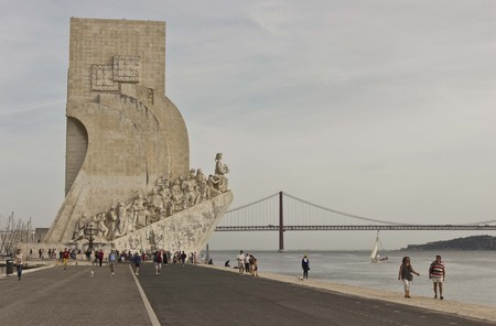 the tagus: LISBON, PORTUGAL - OCTOBER 24 2014: Monument to the Discoveries in Lisbon, with people walkin on the promenade facing the Tagus river Editorial