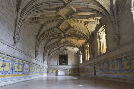 the vaulted: LISBON, PORTUGAL - OCTOBEr 24 2014: Room interiors of Jeronimos monastery in Lisbon, with vaulted ceiling and azulejos on the boards