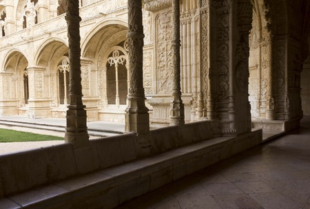 doorways: LISBON, PORTUGAL - OCTOBER 24 2014: Hallway of Jeronimos Monastery in Lisbon, facing the arched doorways of the inner Cloister