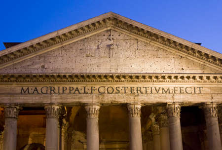pediment: ROME, ITALY - DECEMBER 30 2014: Pantheon pediment close up at night in Rome, Italy