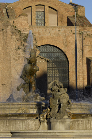 angels fountain: ROME, ITALY - DECEMBER 30 2014: Close up of the fountain in Piazza della Repubblica in Rome, with the Basilica of St. Mary of the Angels behind Editorial