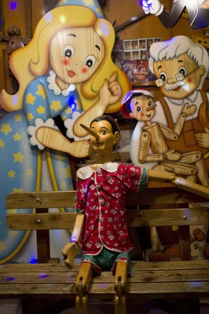pinocchio: ROME, ITALY - DECEMBER 30 2014: Bartolucci window shop in Rome, with wooden manfufacture representing Pinocchio story
