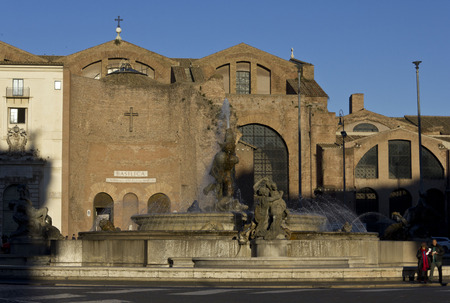 angels fountain: ROME, ITALY - DECEMBER 30 2014: Overview from Piazza della Repubblica of The Basilica of St. Mary of the Angels and the Martyrs and its fountain, Rome