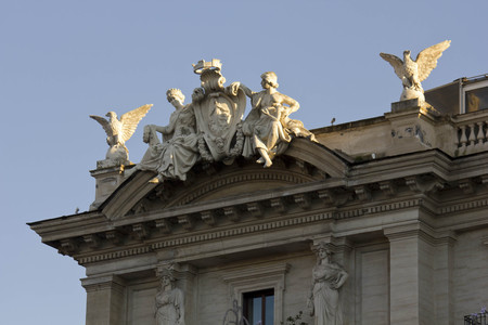 angel statue: ROME, ITALY - DECEMBER 30 2014: Close up of the statues on the building roof of Piazza della Repubblica in Rome