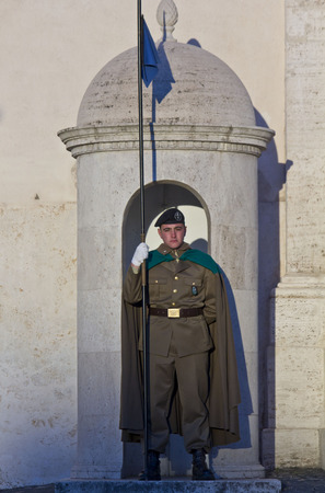 the watcher: ROME, ITALY - DECEMBER 30 2014: Honor Guard holding a flag at Quirinal Palace in Rome, residence of the President of Italy Republic