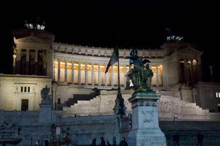 lighted: ROME, ITALY - DECEMBER 30 2014: The Altar of the Fatherland, also known as National Monument to Victor Emmanuel II, lighted at night in Rome, with its equestrian statue in the middle