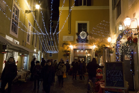 lighted: ROME, ITALY - DECEMBER 30 2014: People at night in Via delle Paste in Rome, lighted for holidays Editorial