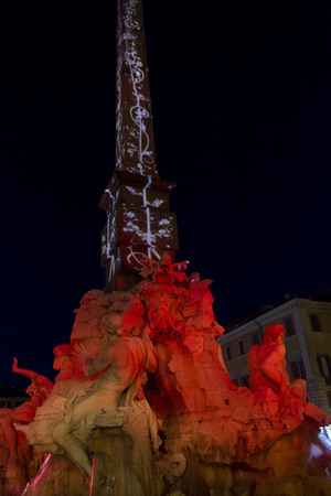 lighted: ROME, ITALY - DECEMBER 30 2014: Architectural close up of the Fountain of the four Rivers and obelisk in Rome, lighted by night
