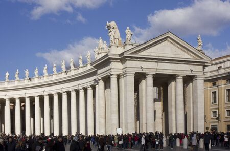 monumental: ROME, ITALY - DECEMBER 31 2014: People in Saint Peter Square in Rome, with its monumental colonnade Editorial