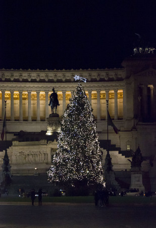 altar of fatherland: ROME, ITALY - DECEMBER 30 2014: The Altar of the Fatherland, also known as National Monument to Victor Emmanuel II, lighted at night in Rome, with a Christmas tree for winter holidays Editorial