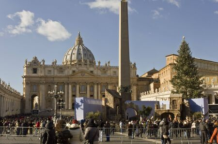 saint peter: ROME, ITALY - DECEMBER 31 2014: Fontal view of Saint Peter Basilica from Saint Peters Square at Christmas time, with the Christmas Tree and the nativity scene and people around