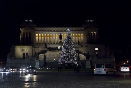 lighted: ROME, ITALY - DECEMBER 30 2014: The Altar of the Fatherland, also known as National Monument to Victor Emmanuel II, lighted at night in Rome, with a Christmas tree for winter holidays Editorial