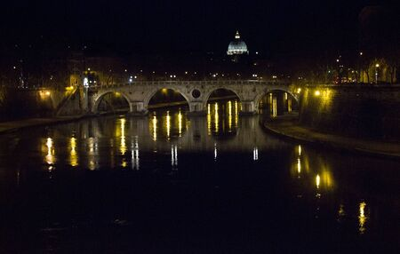 tevere: ROME, ITALY - DECEMBER 30 2014: Ponte Sisto at Night in Rome, on Tevere River with Saint Peter Basilica roof in the background Editorial