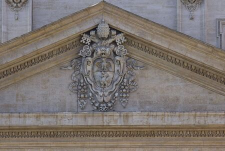 pediment: ROME, ITALY - DECEMBER 31 2014: Close up detail of the pediment of Saint Peter Basilica in Rome