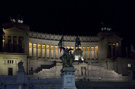 altar of fatherland: ROME, ITALY - DECEMBER 30 2014: The Altar of the Fatherland, also known as National Monument to Victor Emmanuel II, lighted at night in Rome, with its equestrian statue in the middle