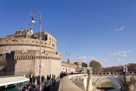 tevere: ROME, ITALY - DECEMBER 31 2014: People walking on Lungotevere Castello with Castel SantAngelo, its bridge and the Tevere river Editorial