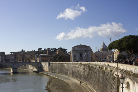 tevere: ROME, ITALY - DECEMBER 31 2014: View from the distance of Saint Peter Basilica from Tiber edge, with people on the street.