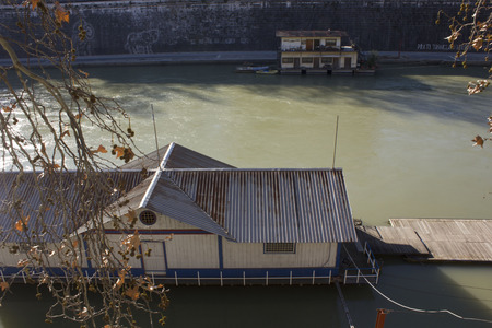 december 31: ROME, ITALY - DECEMBER 31 2014: Houseboats on Tiber River in Rome, Italy Editorial