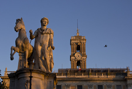 statue: ROME, ITALY - JANUARY 1 2015: Architectural close up of the statues of Piazza del Campidoglio in Rome, with Palazzo Senatorio Tower in the background Editorial