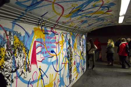 december 31: ROME, ITALY - DECEMBER 31 2014:  Mural by French street artist EpsylonPoint, in the corridor of Rome metro station, Italy