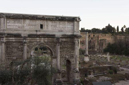 severus: ROME, ITALY - JANUARY 1 2015: The  Arch of Septimius Severus in Foro Romano ruin site in Rome, Italy