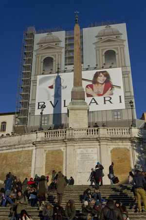 spanish steps: ROME, ITALY - DECEMBER 31 2014: Day view of the Spanish steps of Piazza di Spagna with people on it, and the Trinita dei Monti church under renovation works
