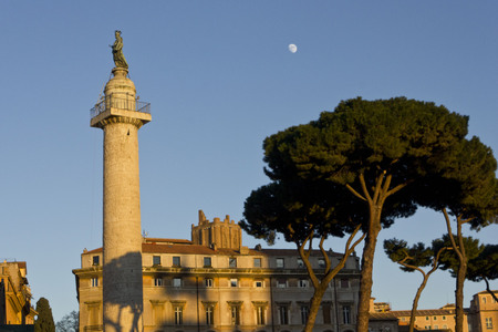 roman pillar: ROME, ITALY - JANUARY 1 2015: Looking up at sunset time to Trajan forum, view of the Trajan column with a tree and the moon in the sky