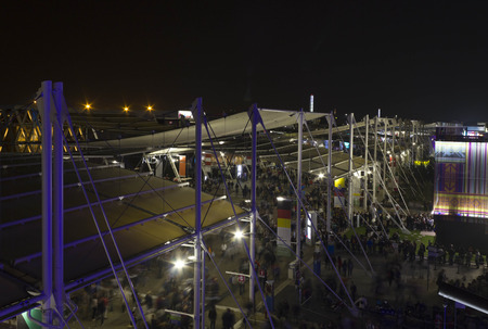 nightview: MILAN, ITALY - OCTOBER 12 2015: View from the top of Expo 2015 area at night, with its pavilion and main promenade. Expo was held in Milan from May to October 2015