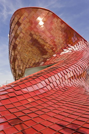 metalized: MILAN, ITALY - JUNE 29 2015: Architectural view of Vanke Pavilion at Expo 2015 in Milan, realized with red ceramic
