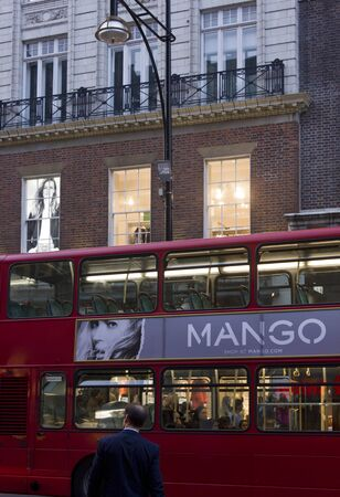 oxford: LONDON, UNITED KINGDOM - SEPTEMBER 11 2015: London red Bus with advertising by Mango in Oxford street in London