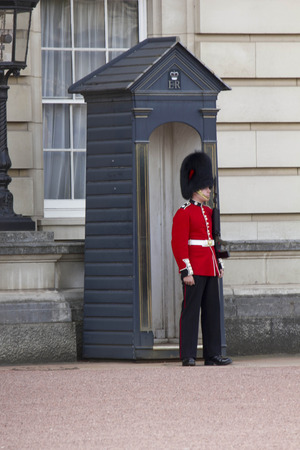 life guard stand: LONDON, UNITED KINGDOM - SEPTEMBER 11 2015: Queen Soldier Guard in Buckhingham Palace in London