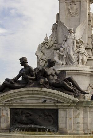 queen of angels: LONDON, UNITED KINGDOM - SEPTEMBER 11 2015: Architectural close up of Queen Victoria Memorial, statues on the bottom with the fountain