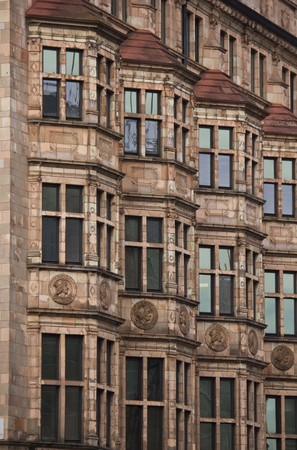 bow window: LONDON, UNITED KINGDOM - SEPTEMBER 11 2015: Architectural close up of a Victorian building in central London, at the corner between Albemarle and Piccadilly streets