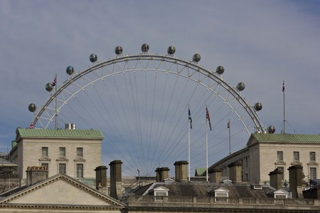 millennium wheel: LONDON, UNITED KINGDOM - SEPTEMBER 11 2015: roof close up of the Horse Guards Palace in London with the Millennium Wheel in the background. Editorial