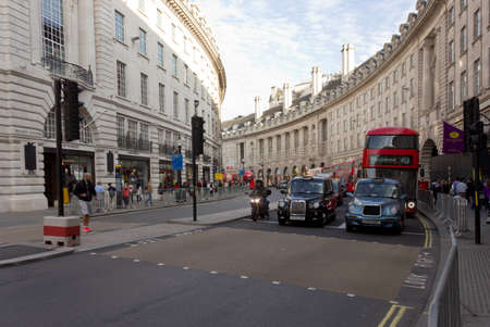 regent: LONDON, UNITED KINGDOOM - SEPTEMBER 11 2015: Regent Street in London, with cabs waiting at the traffic jam Editorial