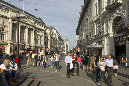 piccadilly: LONDON, UNITED KINGDOM - SEPTEMBER 11 2015: People walking in Piccadilly Circus in London, Day time