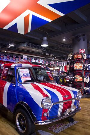 britannia: LONDON, UNITED KINGDOM - SEPTEMBER 11 2015: Mini Cooper painted with the flag of Englad in a Souvenir shop in central London