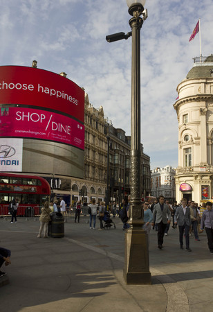piccadilly: LONDON, UNITED KINGDOM - SEPTEMBER 11 2015: Piccadilly Circus in London, view of the famous advertising neon signs with people walking around